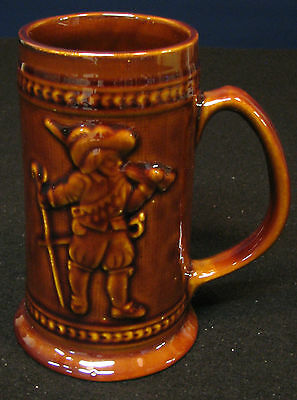 5 ½ in. tall beer mug decorated witha swordsman. Number 132