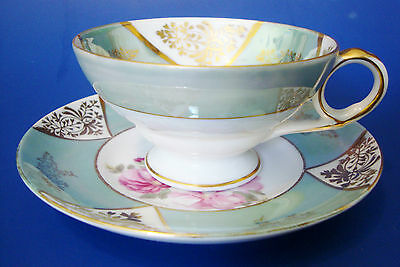 Porcelain Iridescent footed Cup & Saucer Old Gold Japan