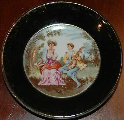 SGK Decorative Plate Of Colonial Woman & Man Playing Guitar Black W Gold Design