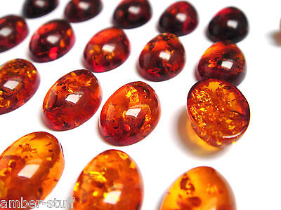 Cognac Baltic amber oval cabs  13mm x 9mm best quality from dark - light colour