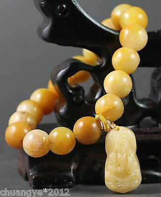 Chinese pure natural jade stretchy bracelet with hand-carved guanyin beads