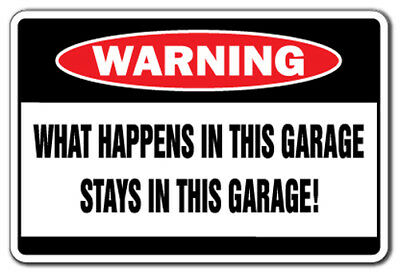 WHAT HAPPENS IN THIS GARAGE Warning Sign funny signs man room cave TV smoke beer