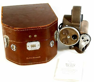 BELL AND HOWELL 70-DR 16MM CAMERA WITH CASE AND CRANK AND MANUAL WORKING