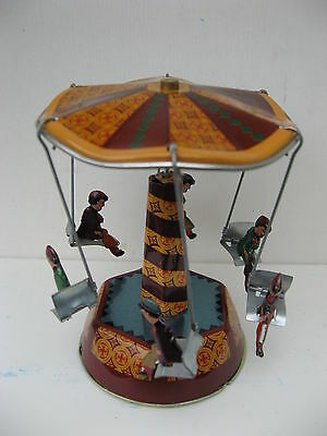 Carousel - Tiny Tin Merry-Go-Round  -  The Fun Of The Fair In A Classic Wind-Up!
