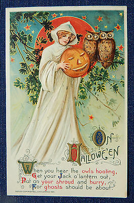 Halloween Postcard - 1911 -Woman in White Cape holding a Jack o Lantern - Winsch