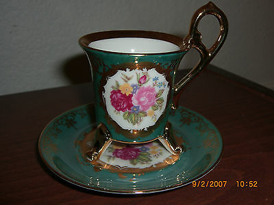 VINTAGE KPM FOOTED DEMITASSE CUP AND SAUCER WITH ROSES ON WHITE FIELD