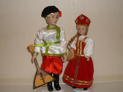 "2 porcelain dolls in the  7.5"" beautiful doll in Russian dresses balalaika"