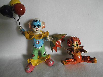1 Paper Mache Clown figure with Balloons & 1 with an Umbrella.