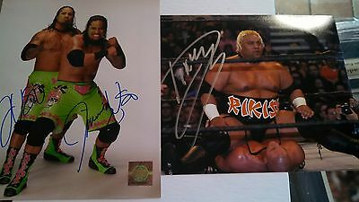 WWE tag team championsThe USOS. And  Rikishi autographed 8x10