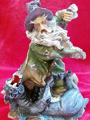 Wizard Statue Figurine in Battle with a Gold Horned Blue Dragon