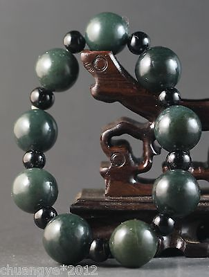 Chinese natural hetian jade stretchy bracelet with hand-carved beads