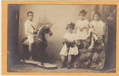 Studio Real Photo Postcard RPPC - Boy on Hobby Horse - Girls with Toys