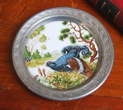 A Kaiser vintage pin tray with a bird, black grouse picture, pewter rim