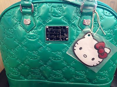 LOUNGEFLY HELLO KITTY EMERALD EMBOSSED PATENT TOTE  ( 100% Brand New )