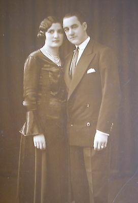 LADY w/EXCEPTIONAL BLACK SATEEN BLOUSE & SKIRT MAN w/ DOUBLE BREASTED COAT PHOTO