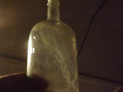 VINTAGE ANTIQUE BEEF WINE AND IRON  WHISKEY BOTTLE