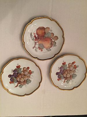 "Decorative plates from Germany, 3 of them, with fruit design  8"" diameter"