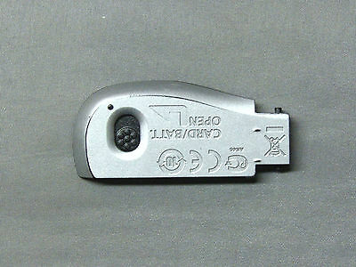 CANON POWERSHOT A1200 BATTERY DOOR ... SILVER ... USED ... OEM