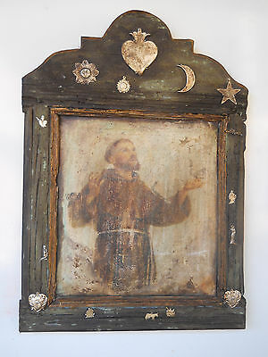 Vintage frame and painting with Saint Francis. Nice decoration