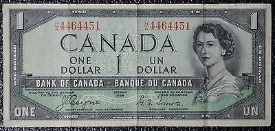 BANK OF CANADA - 1954 $1 DEVIL'S FACE CHANGEOVER NOTE - Prefix H/A-Coyne&Towers