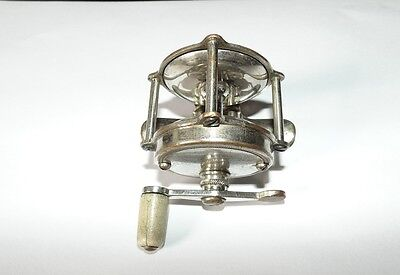Vintage/ antique small fishing pole reel # 40, Silver in color