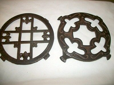 Two Antique Vintage Cast Iron Trivets One Has Paw Feet