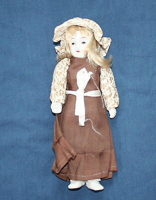 Blond Haired Porcelain Doll 7""