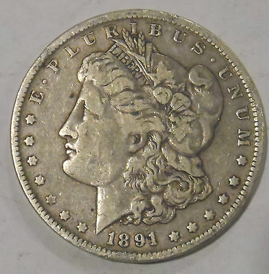 1891 O   MORGAN DOLLAR  IT IS A FINE HAS A LOT OF DETAIL LEFT