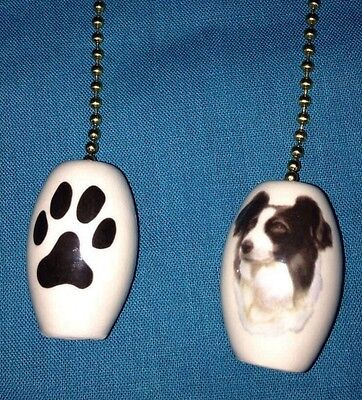 """One Border Collie Dog Fan Pull With Paw Prints On The Back 1"""""""
