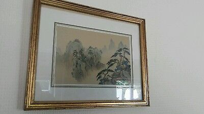 A small glazed and framed Chinese classical landscape painting on silk