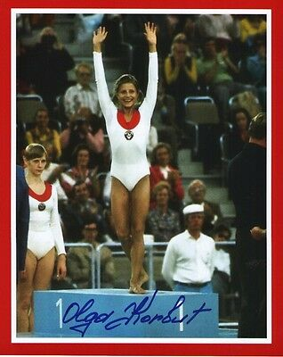 """OLGA KORBUT SIGNED 8x10 PHOTO - """"TOP OF THE PODIUM""""- 1972 OLYMPICS, GOLD MEDAL"""