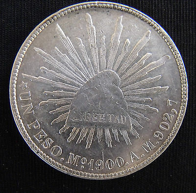 Circulated 1900 Mo-AM Mexico Un Peso Silver Coin....