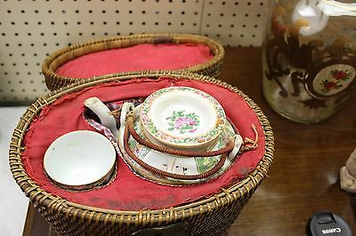 Antique Chinese Rose Medallion Teapot & cup in a warming basket, Qing dynasty