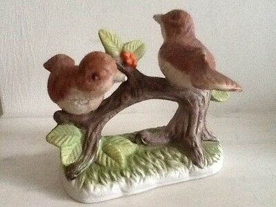 Pair of decorative birds on a branch