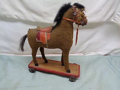 Antique Primative Child's Fabric covered pull toy horse