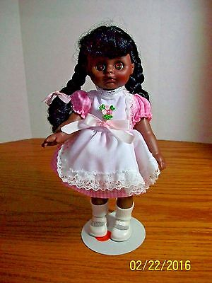 Vintage 9 inch Vinyl & Plastic African American doll in Original Outfit