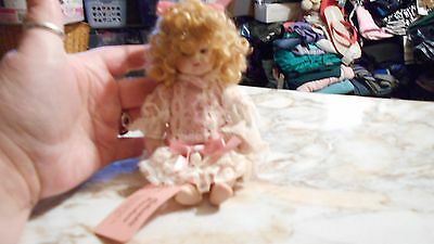 Show Stoppers Inc 7 inch Hand Painted Porcelain Doll Blond Haired/Brown Eyed