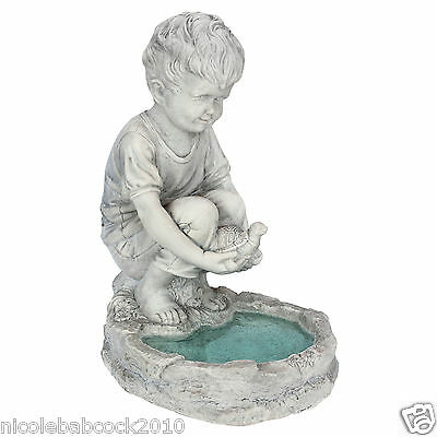 European pond statue boy & his turtle echos peace tranquility & meditation