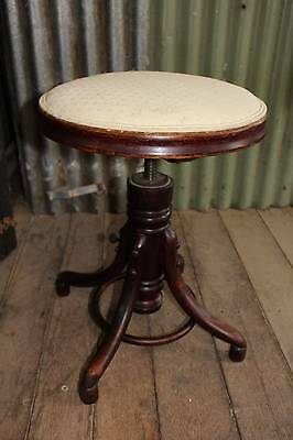 An Antique Austrian Made Revolving Bentwood Piano Stool