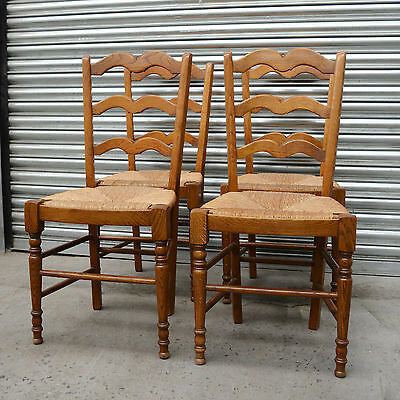set 4 x French oak ladder back rush seated dining chairs