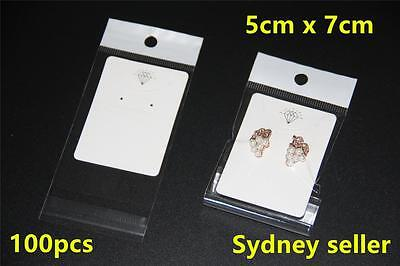 100x White Earring Pendant Chain Jewellery Display Cards 5x7cm + 100p 6x9cm Bags