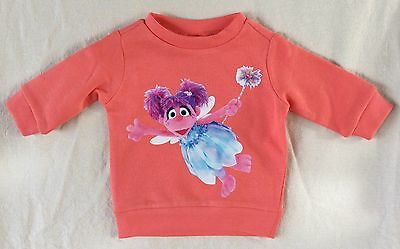 Baby Girls Size 000 Fleecy Jumper With Abby Cadabby Picture