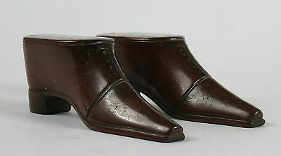 A pair of 19th century treen nailwork shoe snuff boxes