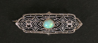 White gold filigree and opal brooch, stamped 14K