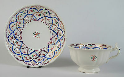Gaudy Welsh lustre teacup and saucer. Possibly Swansea. c1895