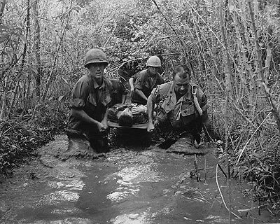 "Soldiers carry a wounded comrade through a swamp 8""x 10"" Vietnam War Photo 154"