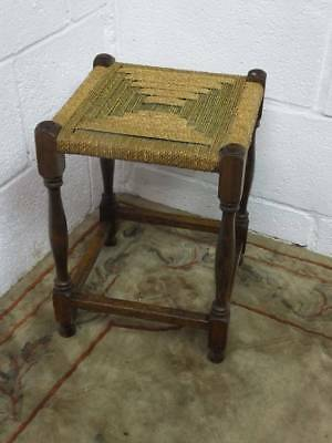 A SOLID OAK STOOL With RUSHED / WICKER SEAT