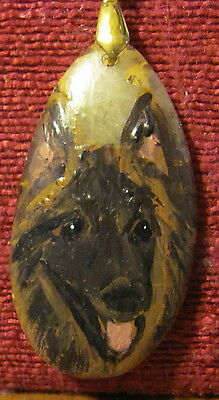 Belgian Tervuren hand painted on a long, narrow pendant/bead/necklace