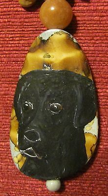 """Flat Coated Retriever hand painted on an oblong, 2 1/4"""", composite pendant/,bead"""