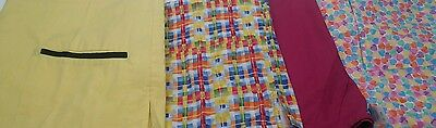 Lot of 4 scrub tops size large in a variety of colors and patterns.